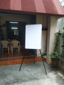 tripod stand with white board