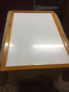 white board with wooden frame